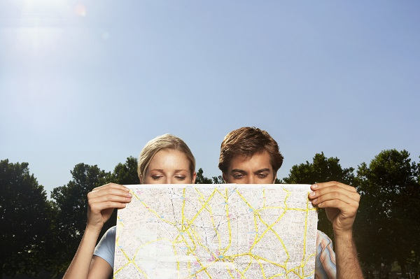 http://www.dreamstime.com/stock-photography-vacationing-couple-looking-large-map-closeup-park-image31836082