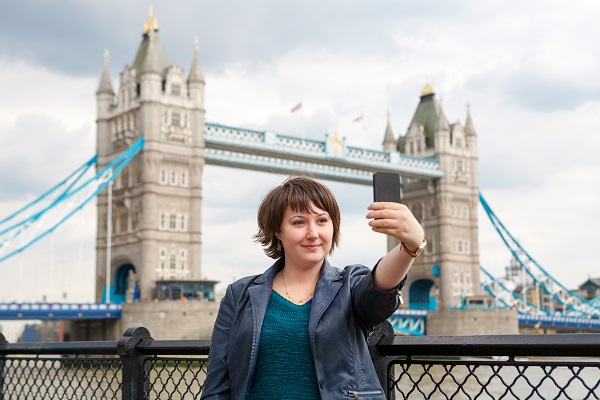 http://www.dreamstime.com/stock-photo-photograph-herself-london-uk-young-woman-taking-photo-front-tower-bridge-england-image36088290