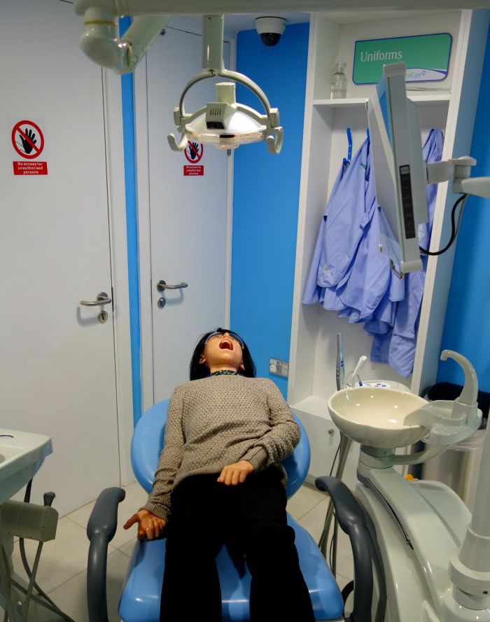 Playing at being the dentist at KidZania