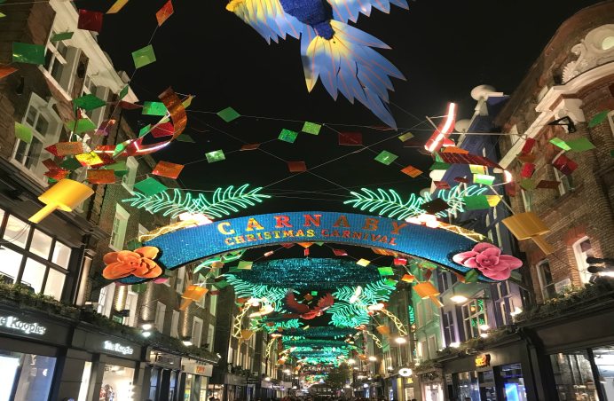 getting into the celebratory spirit the carnaby christmas lights are feeling the carnival vibe with warm colours of reds greens and yellows