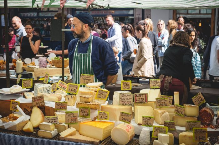 Solo travel London - A cheese monger at Broadway Market, Hackney