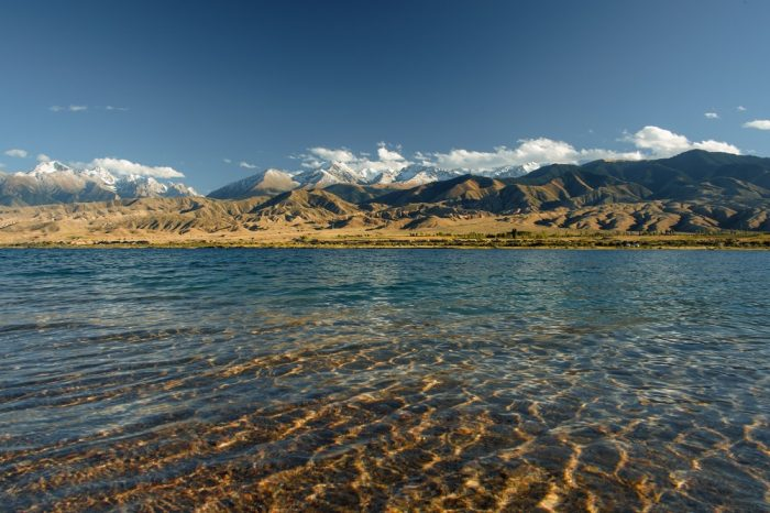 The crystal clear waters of Lake Issyk Kul, Kyrgyzstan